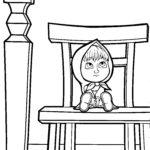 Маша за столом на стуле